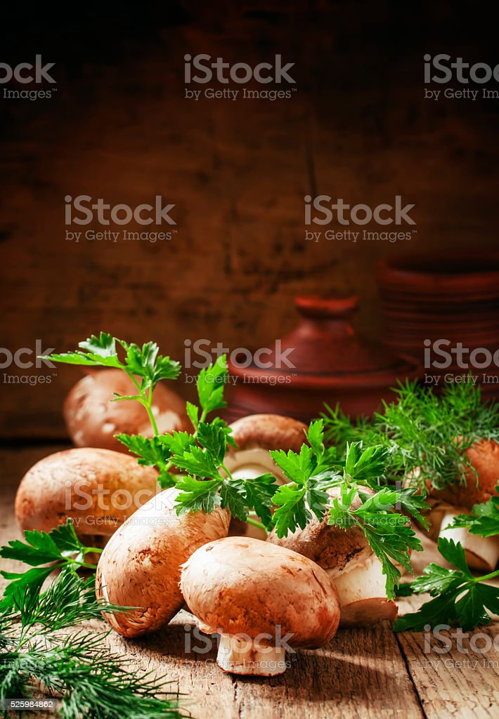 Brown mushrooms on a vintage wooden table stock photo