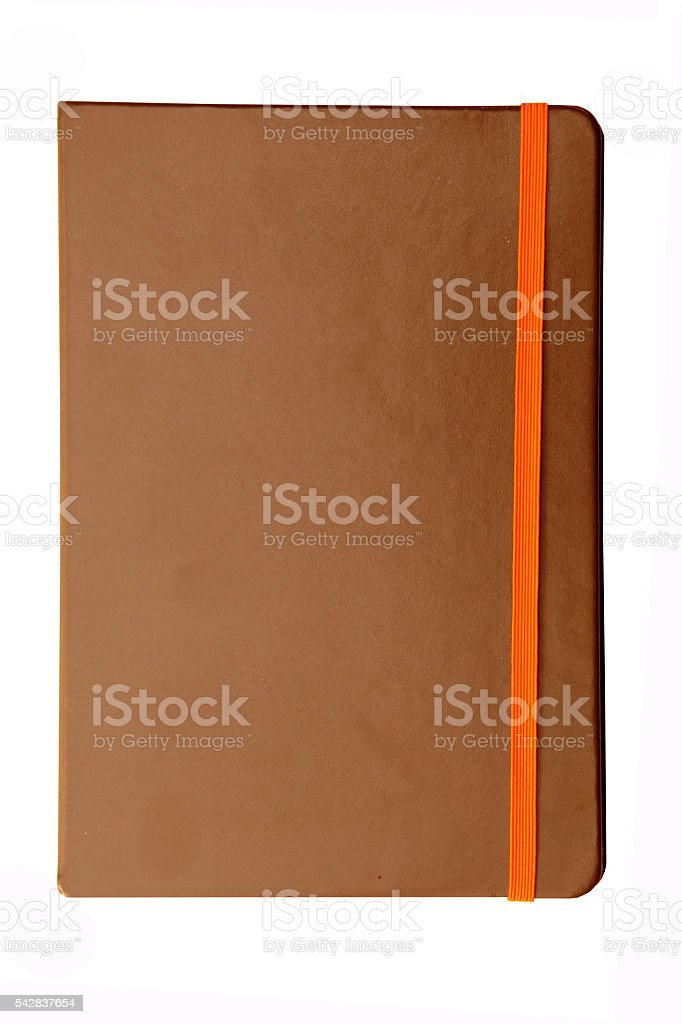 Brown note book with elastic band  isolate on white background stock photo