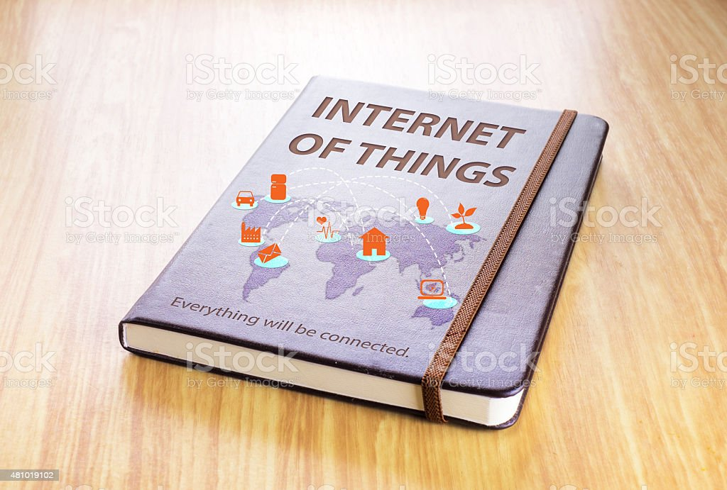 Brown notebook with Internet of things word and global map stock photo