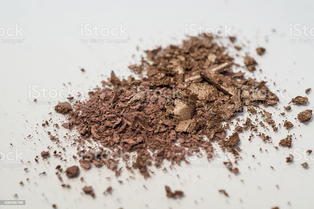 brown, nudes, neutral and gold makeup powder shadow stock photo
