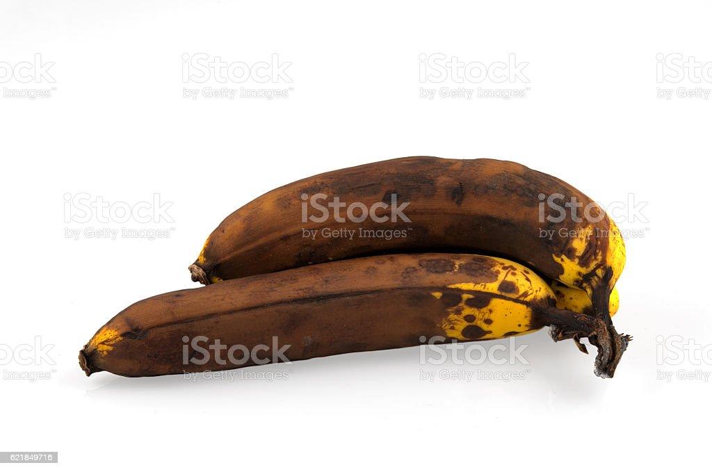 brown overripe bananas on white background stock photo