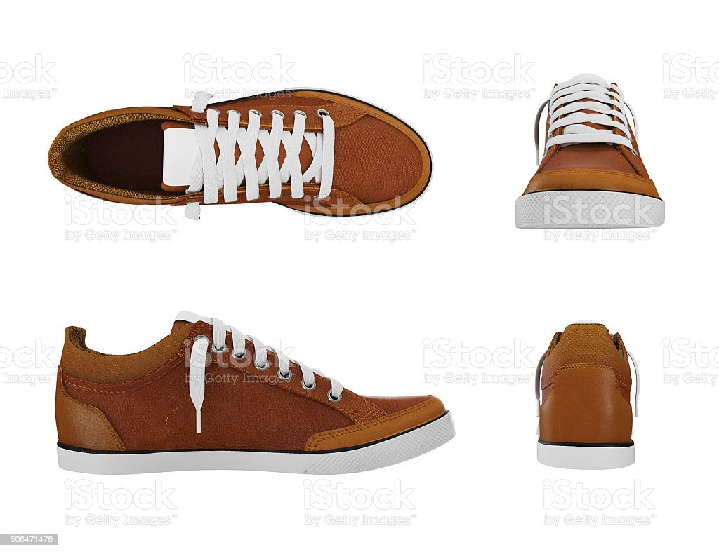 Brown pair of sport sneakers from four side stock photo