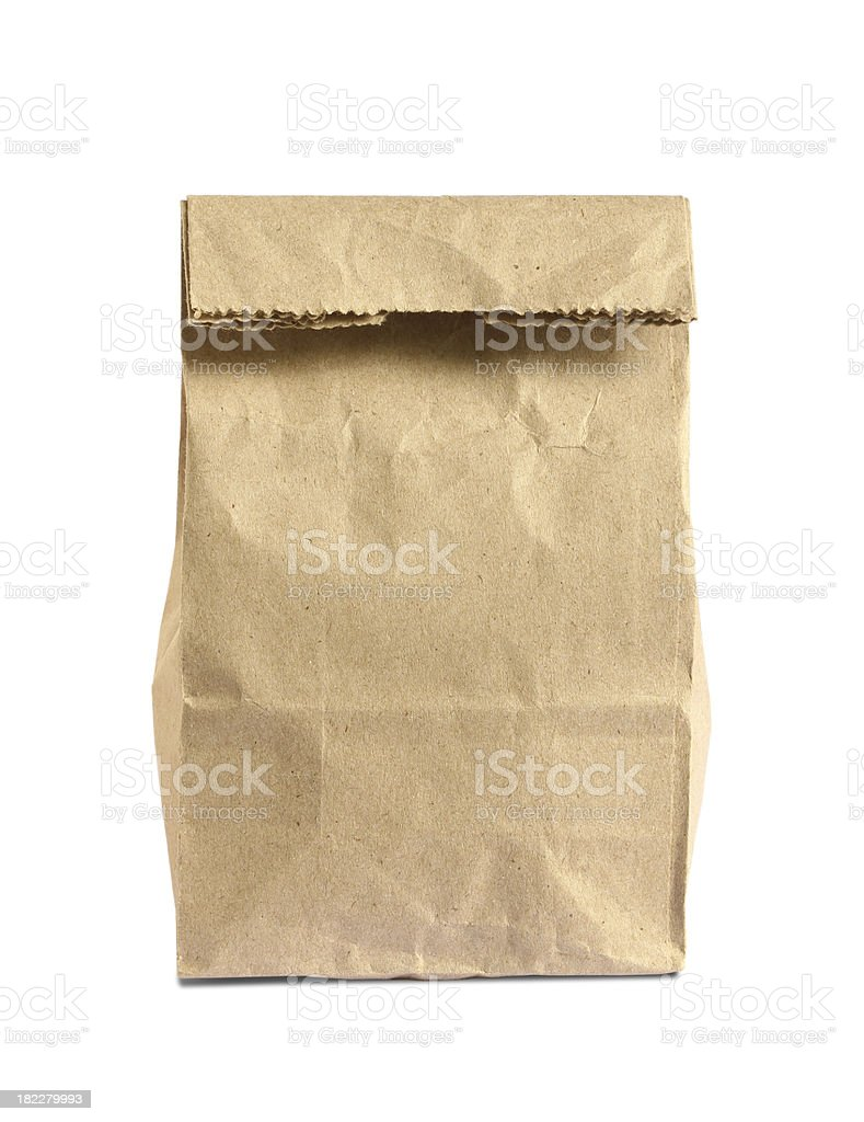 Brown paper bag folded over on white background stock photo