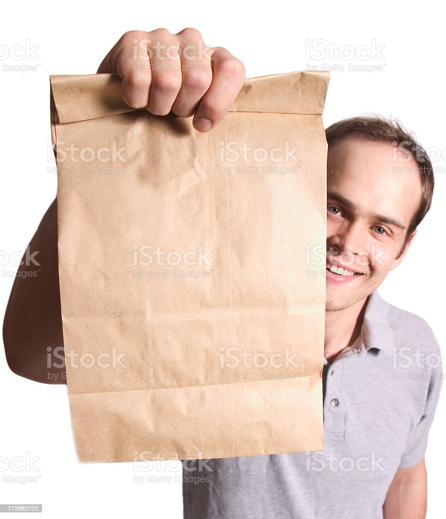 Brown paper bag handed over by man stock photo