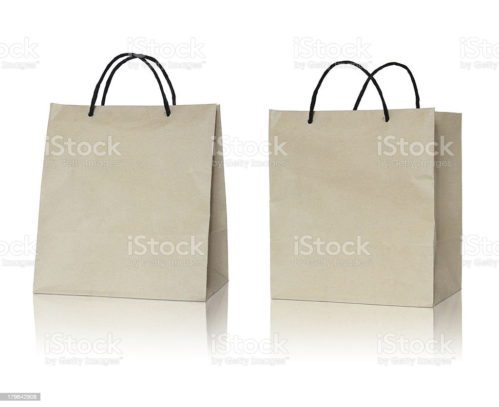 Brown paper bag on reflect floor and white background stock photo