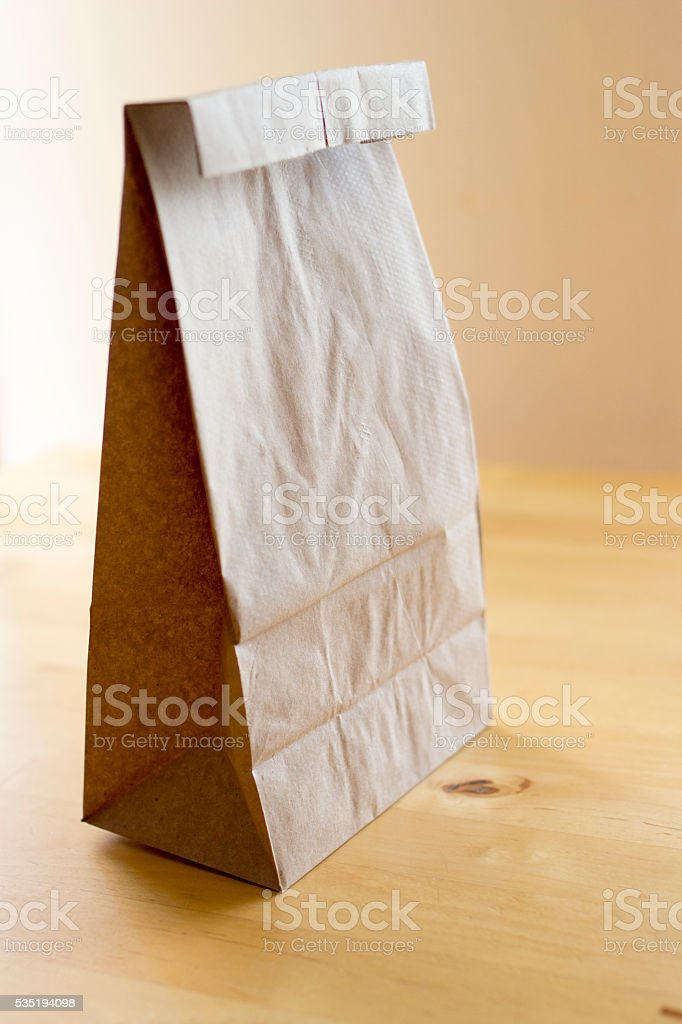 Brown paper bag on wood table stock photo