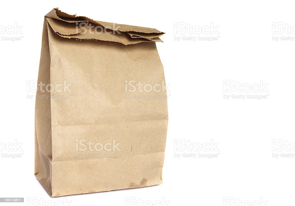 Brown paper bag with small grease stain isolated on white stock photo