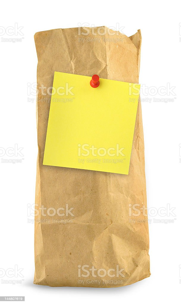 brown paper bag with yellow note stock photo