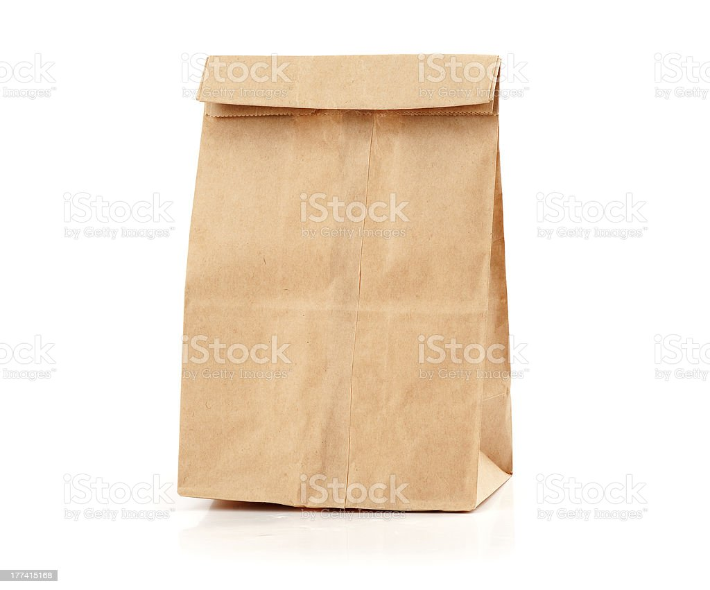 Brown paper lunch-bag folded closed on a white background stock photo