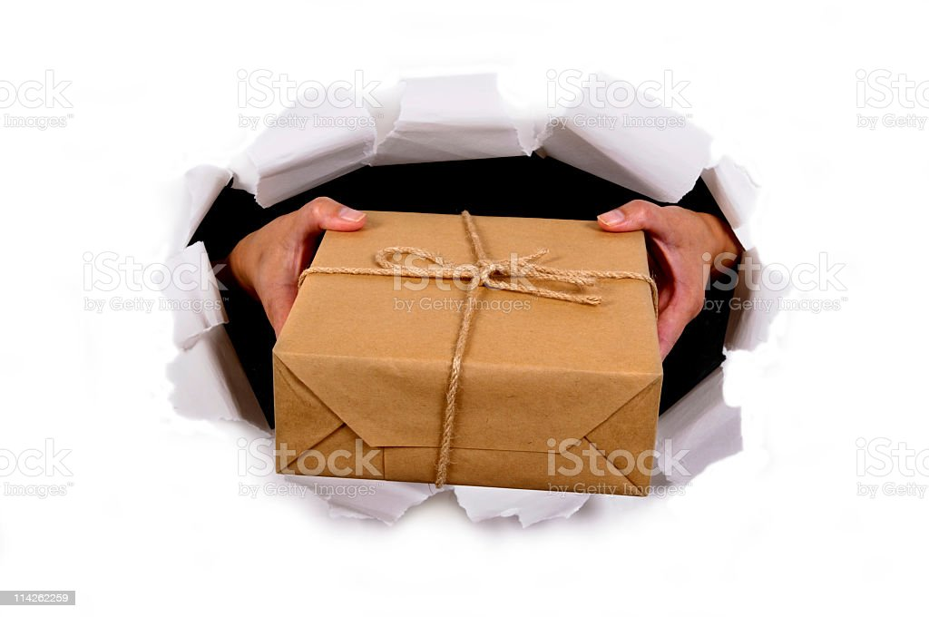 Brown paper package bursting through background royalty-free stock photo