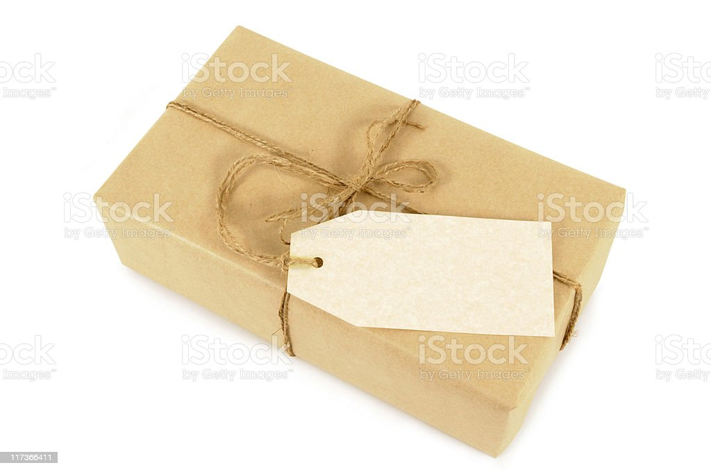 Brown paper package tied with string royalty-free stock photo