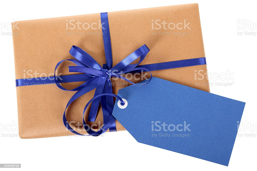 Brown paper package with blue gift tag stock photo