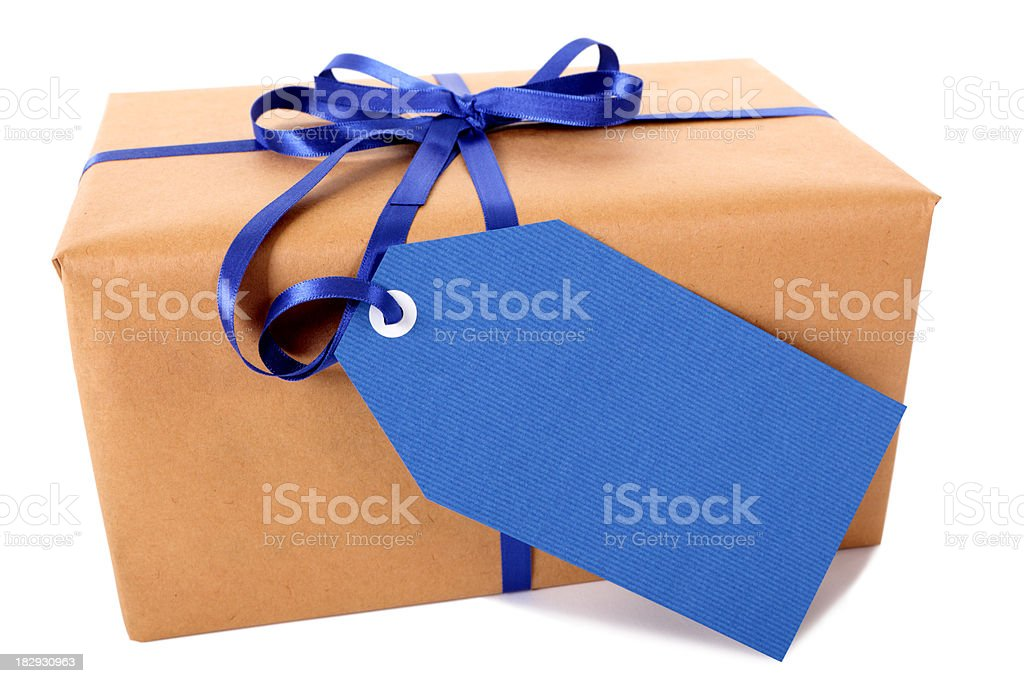 Brown paper package with blue gift tag royalty-free stock photo