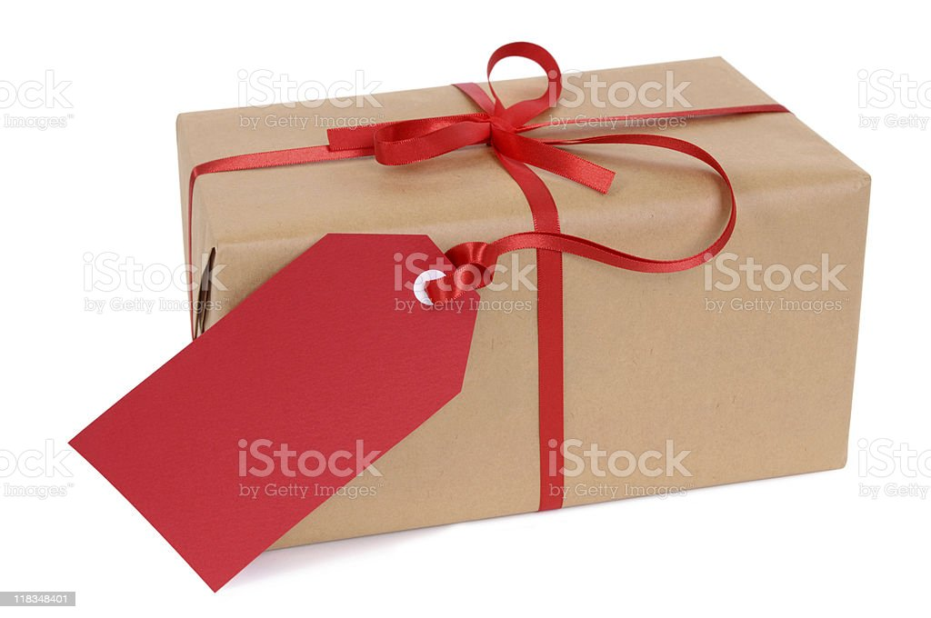 Brown paper package with red ribbon and tag stock photo