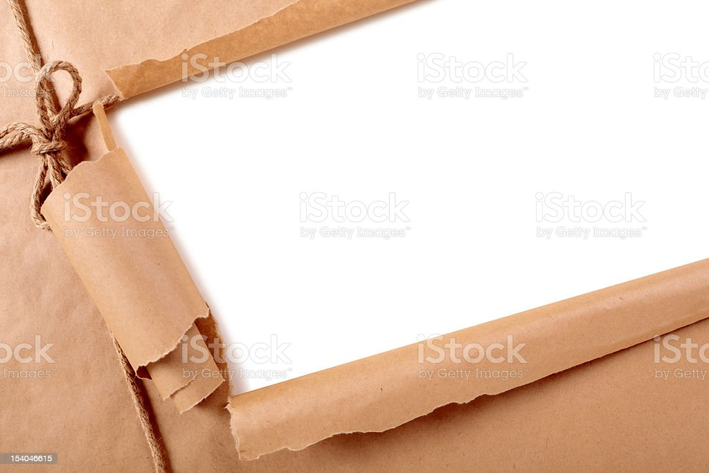 Brown paper package with torn section royalty-free stock photo