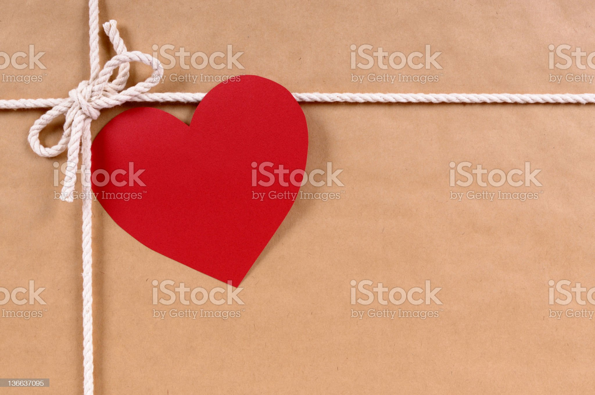 Brown paper package with valentine card royalty-free stock photo