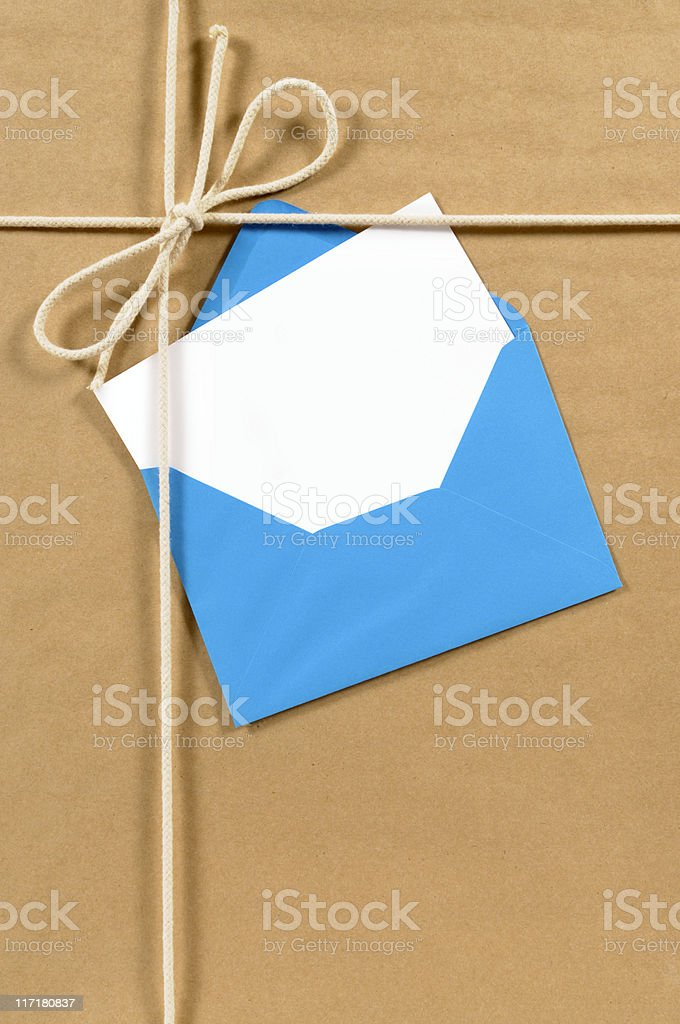 Brown paper parcel with blue envelope stock photo