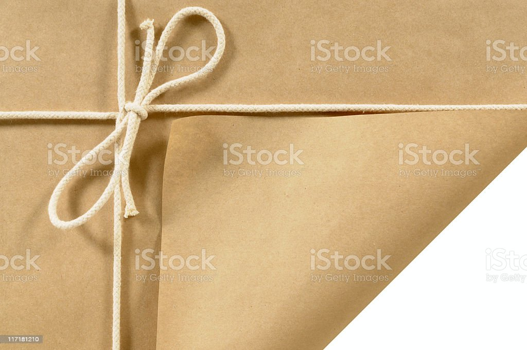 Brown paper parcel with curled corner royalty-free stock photo