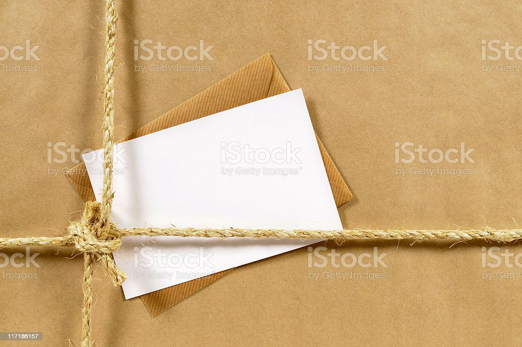 Brown paper parcel with envelope stock photo