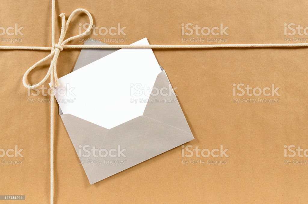 Brown paper parcel with silver envelope royalty-free stock photo