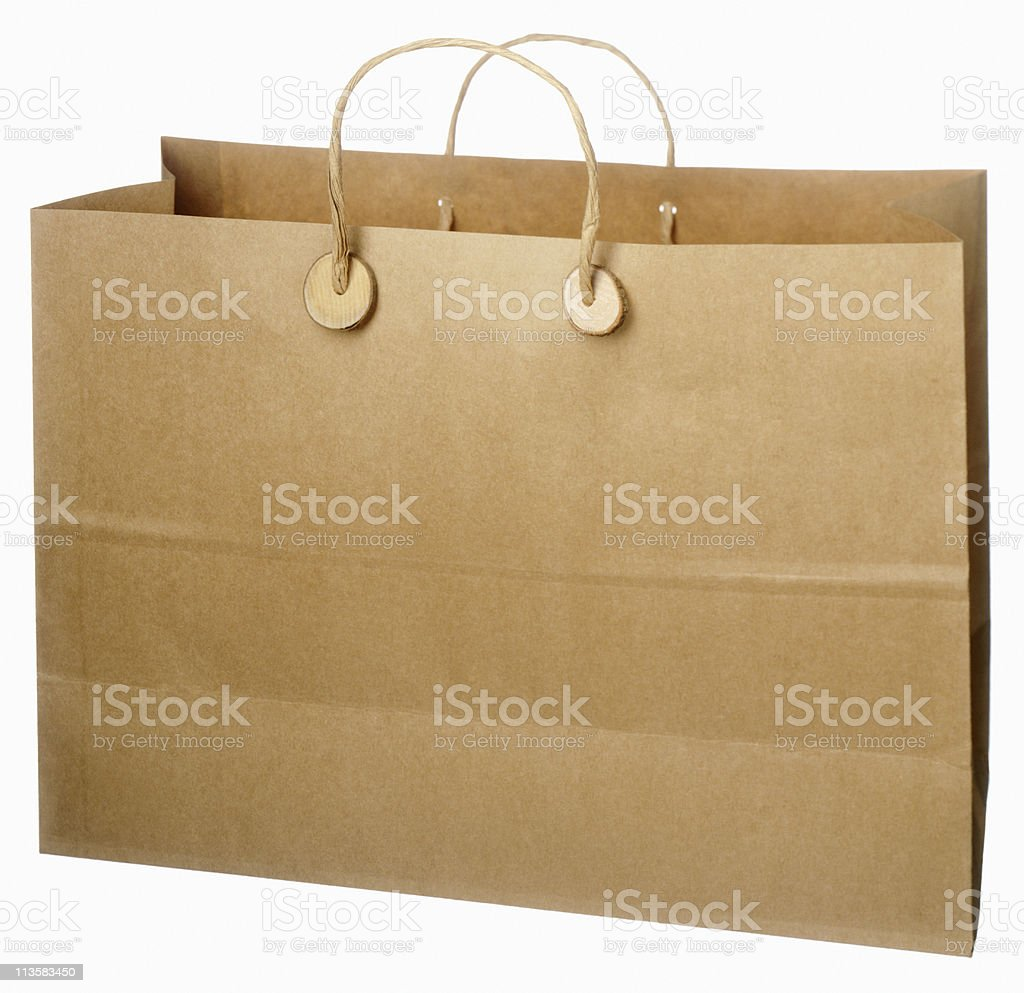 brown paper shopping  bag cut out on white royalty-free stock photo