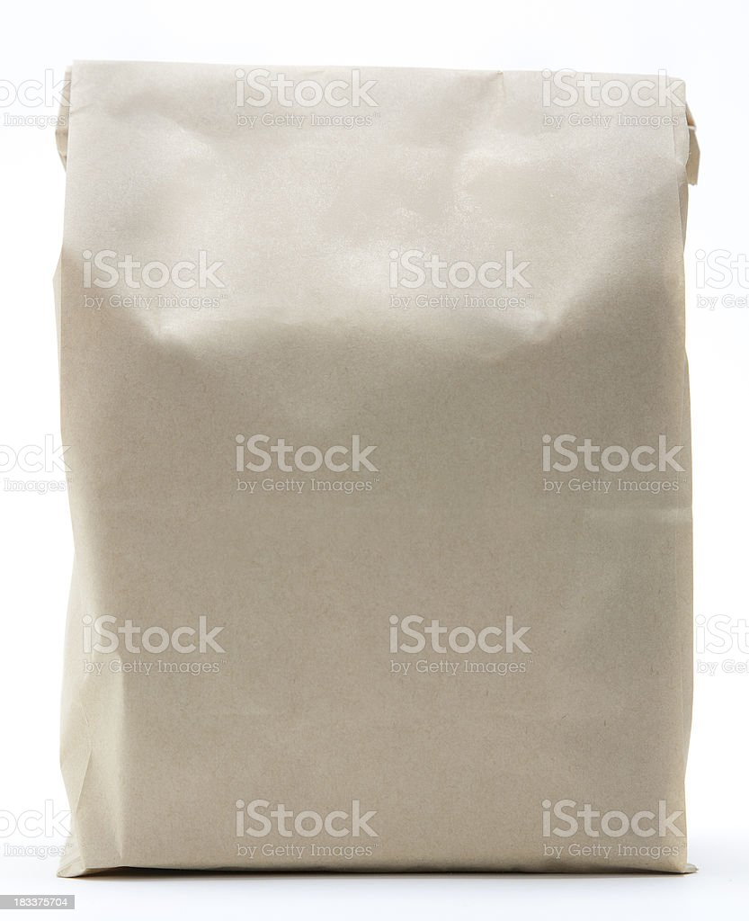 Brown paper shopping bag folded closed royalty-free stock photo