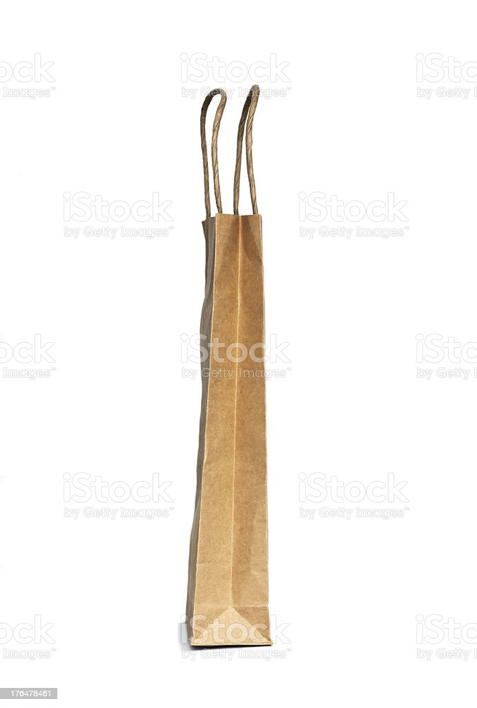Brown paper shopping bag isolated on white background, copy space royalty-free stock photo