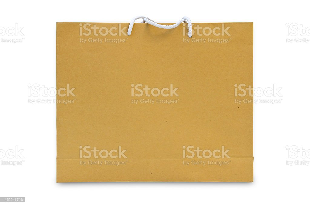 brown paper shopping bag isolated royalty-free stock photo