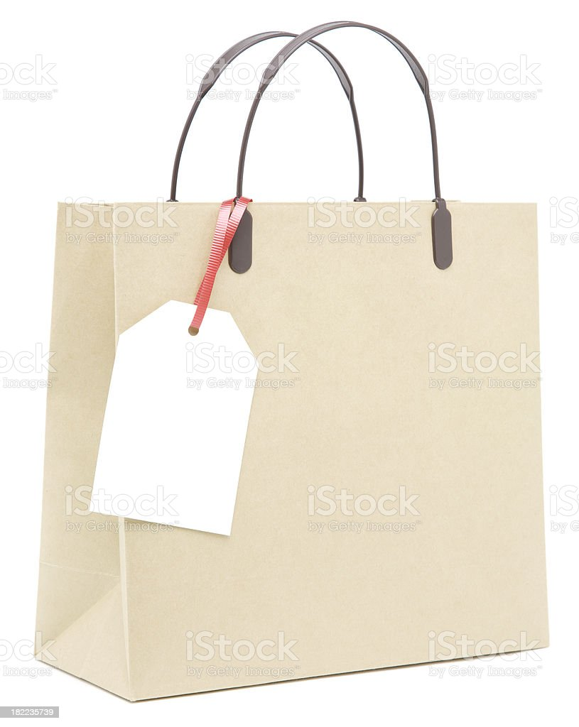 Brown paper shopping bag with blank label royalty-free stock photo