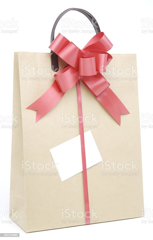 Brown paper shopping bag with red ribbon bow royalty-free stock photo