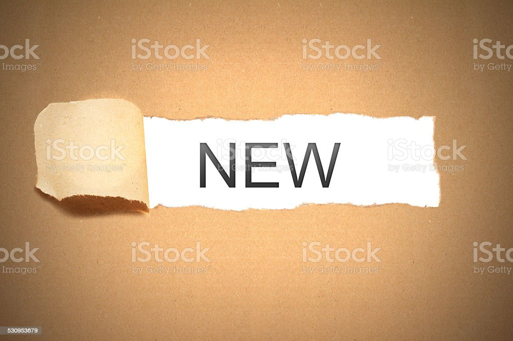 brown paper torn to reveal new stock photo