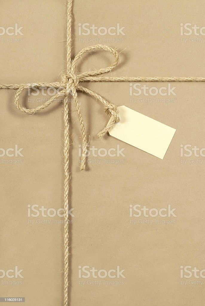 Brown parcel with rope and tag royalty-free stock photo