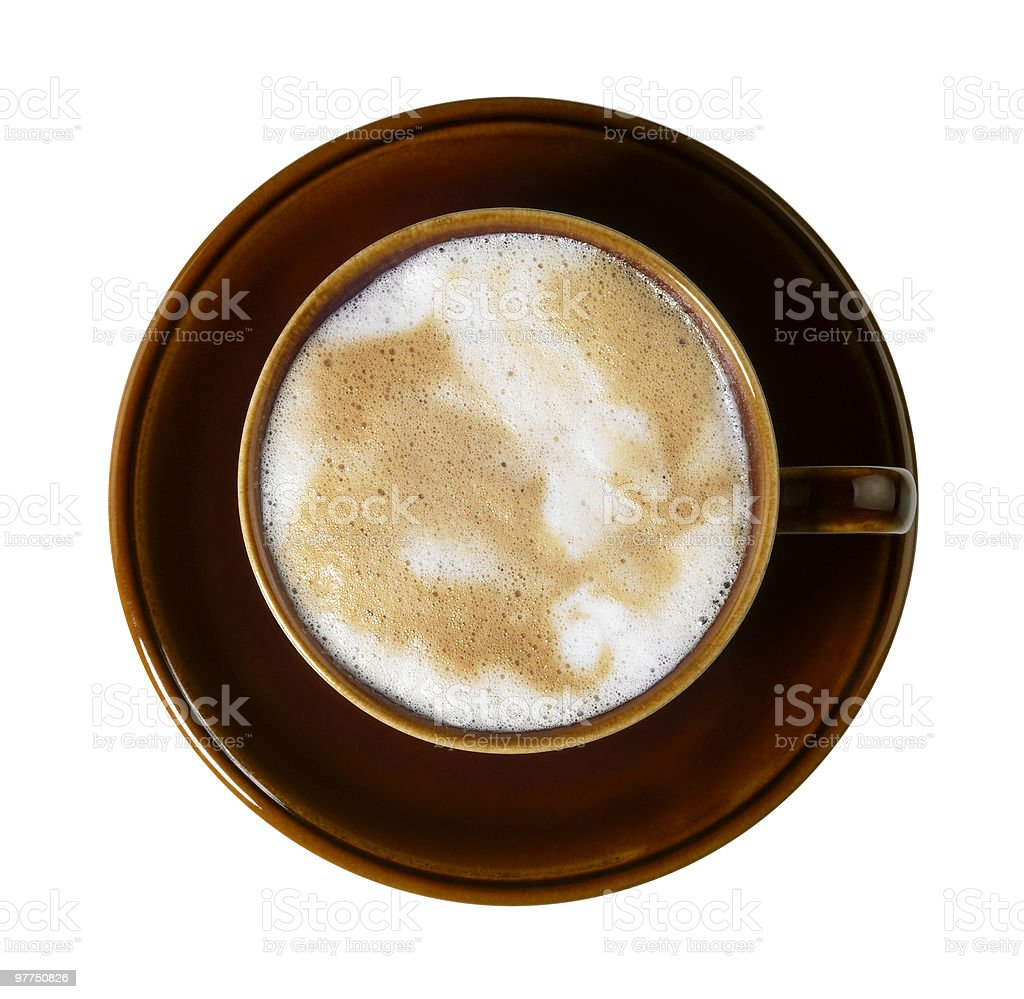 brown porcelain cup with marbled milk froth stock photo