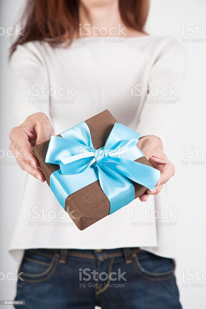 brown present in woman hands stock photo