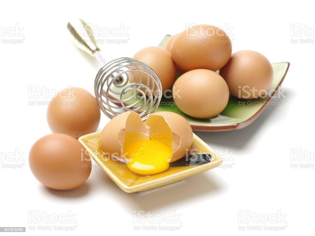 Brown raw chicken eggs  isolated on the white background stock photo