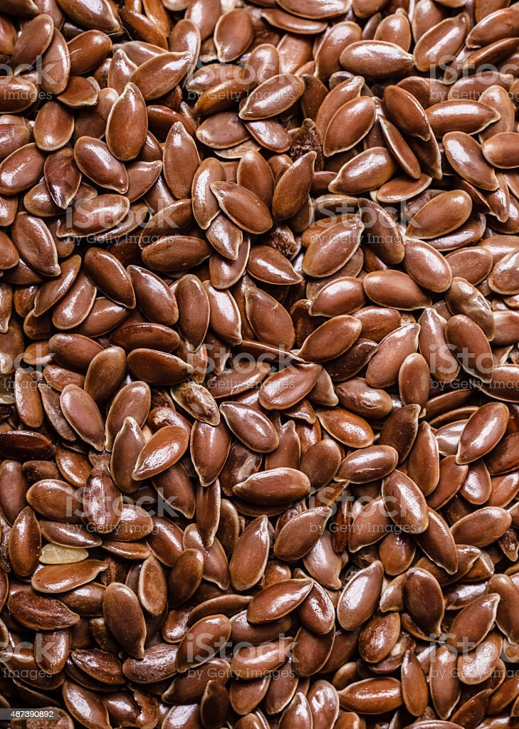 Brown raw flax seeds linseed as background stock photo