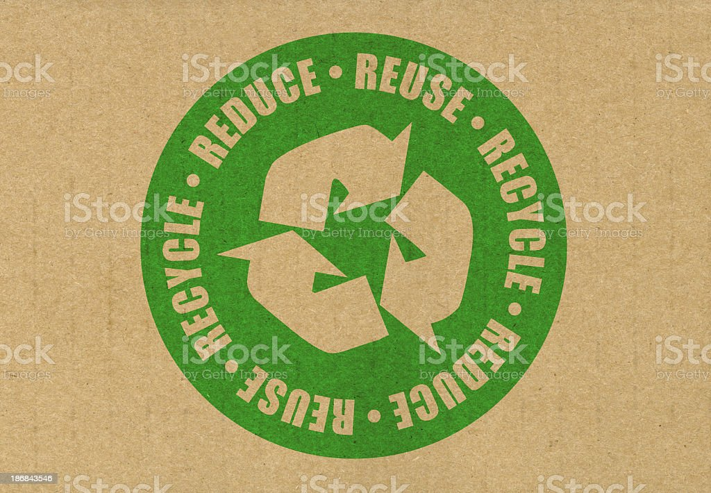 Brown recycle paper with a green circular symbol stock photo