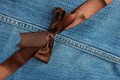 Brown ribbon diagonal on jeans