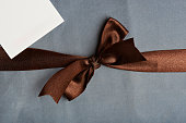 Brown ribbon on light blue background