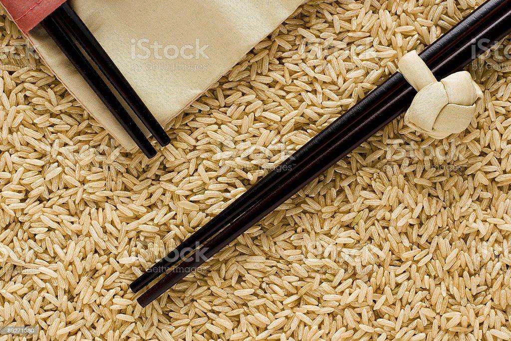 Brown rice and chopstics stock photo