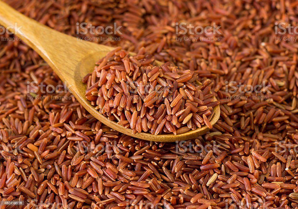 Brown Rice and Spoon stock photo