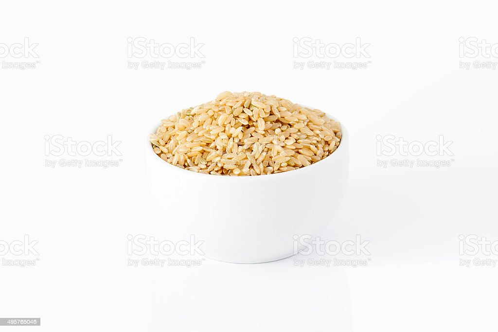 Brown rice in a bowl stock photo