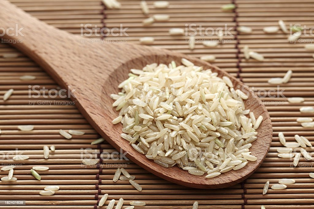 Brown rice in a wooden spoon royalty-free stock photo
