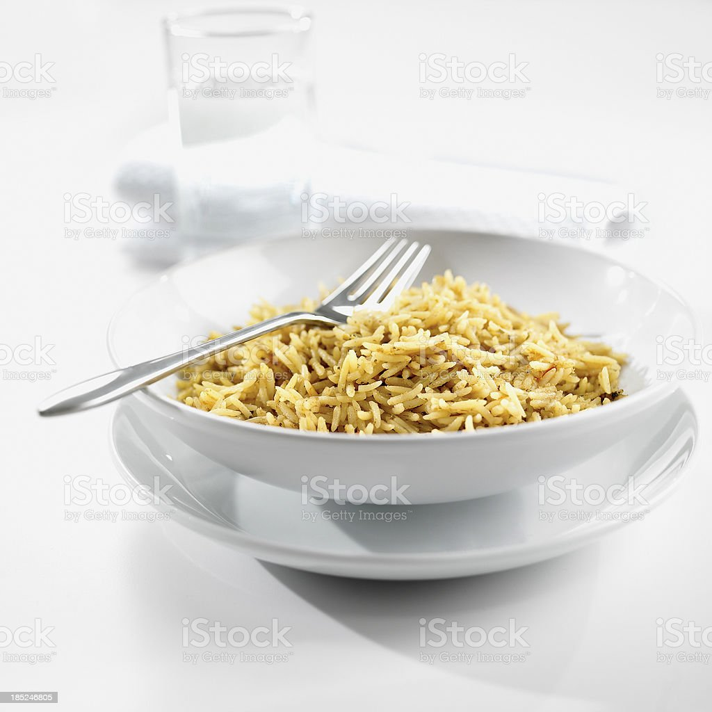 Brown rice in bowl on white background royalty-free stock photo