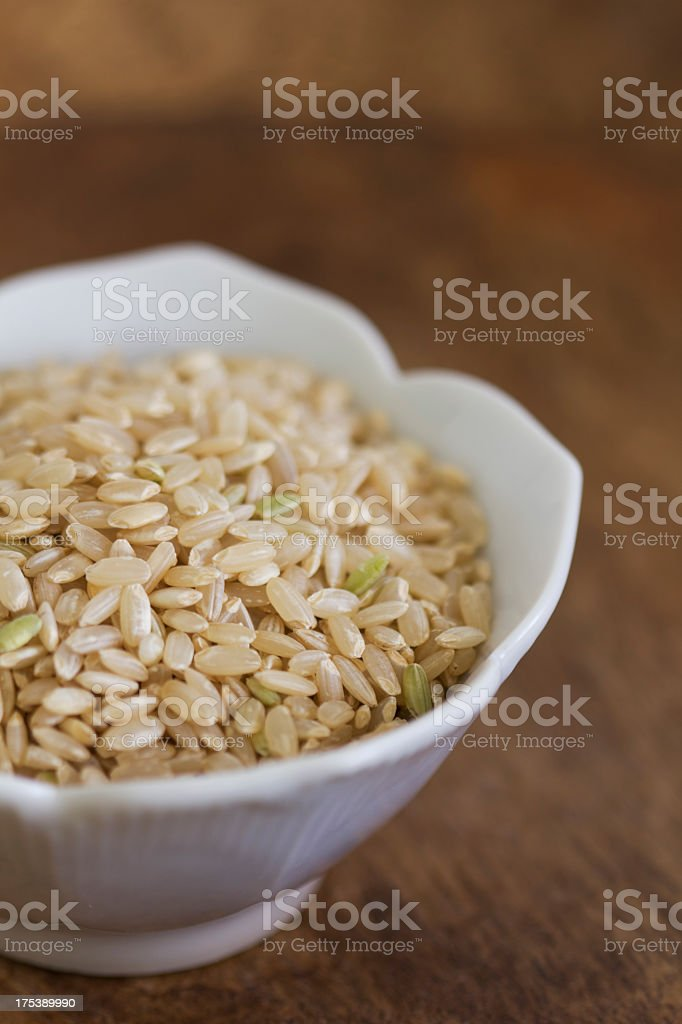 Brown rice in bowl royalty-free stock photo