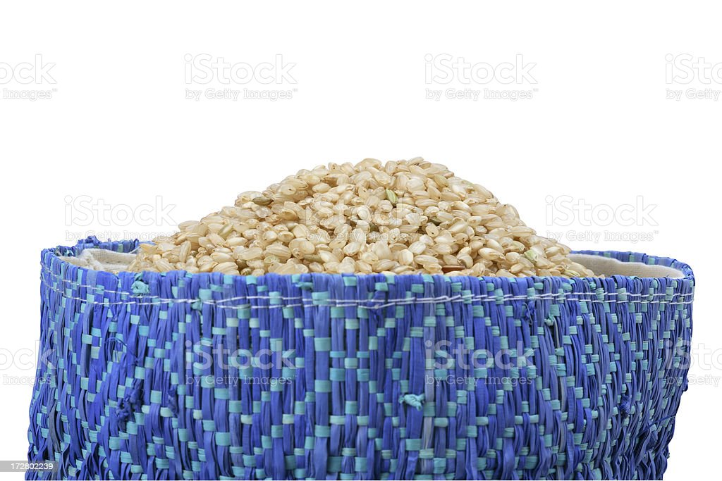 Brown rice on a blue bag. royalty-free stock photo