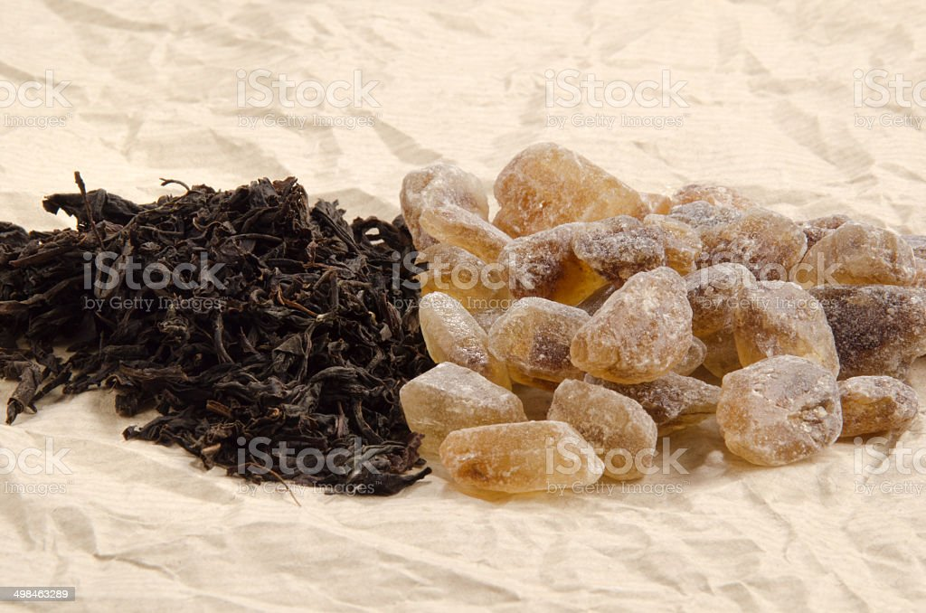 brown rock candy sugar and black tea royalty-free stock photo