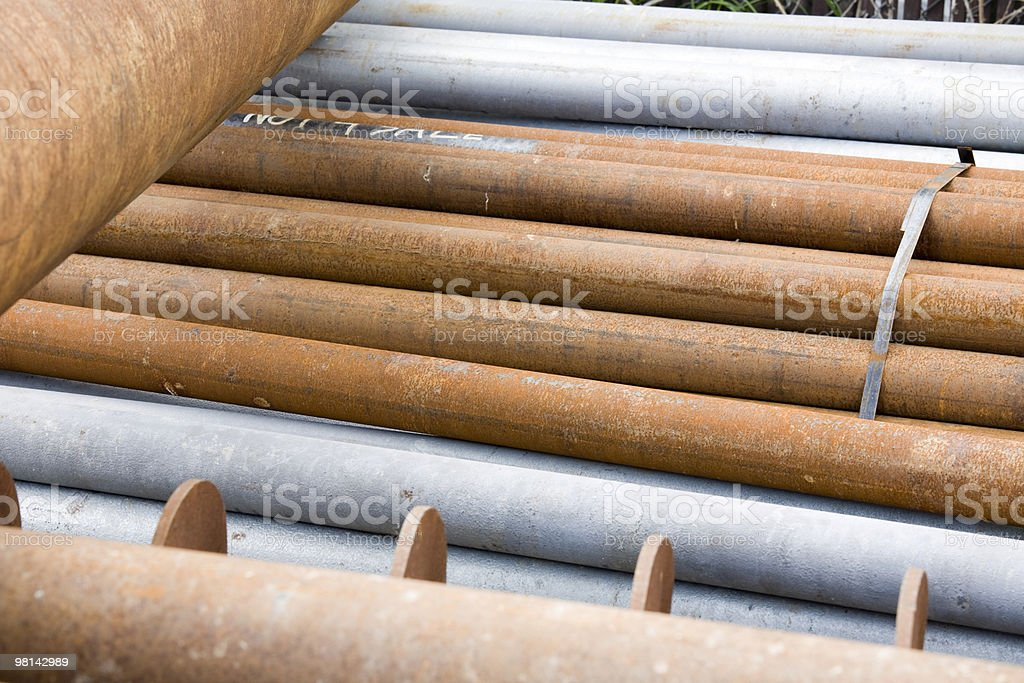 Brown rusty metal pipes stock photo