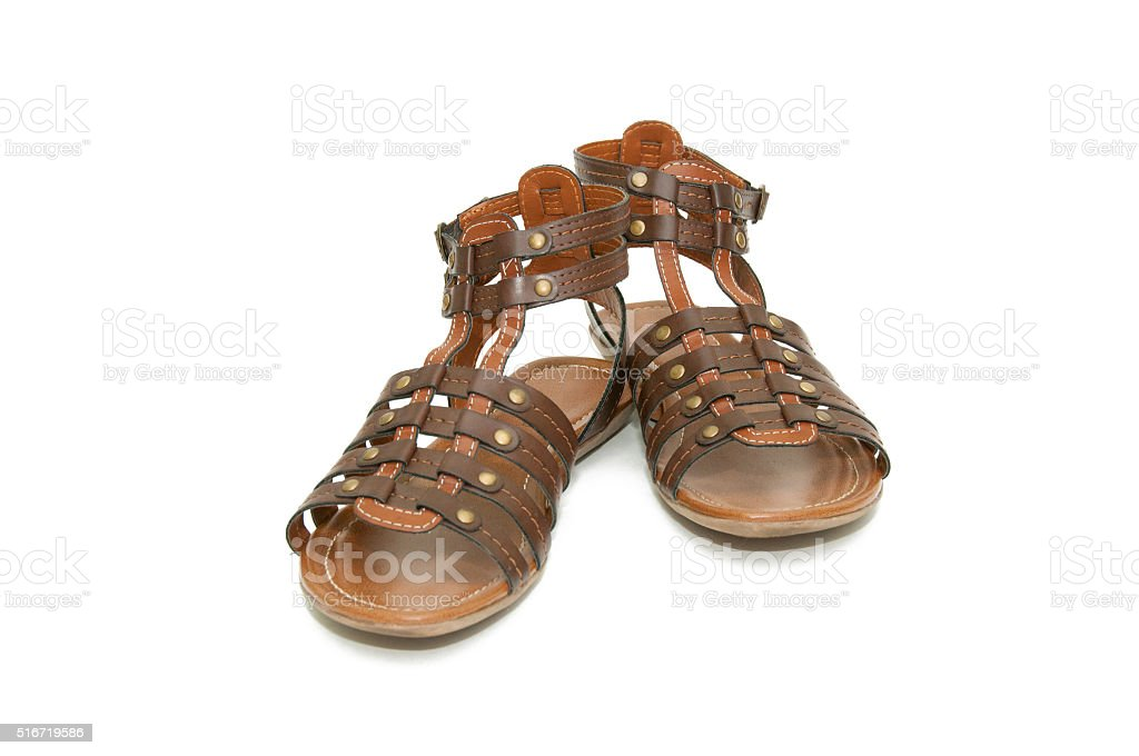 Brown sandals (gladiators) on white background stock photo