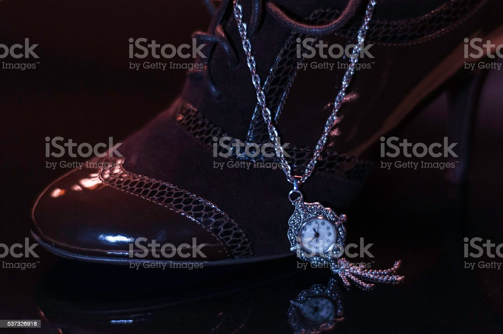 Brown shoe with watch stock photo